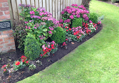 Commercial grounds hedge maintenance
